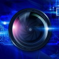 Camera lens in front of circuit board