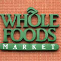 Whole Foods sign on brick wall