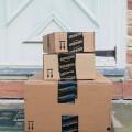 Amazon and Amazon Prime boxes on doorstep