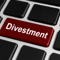"Word ""divestment"" on red key in jeyboard"
