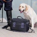 Dog and security guard standing behind bag