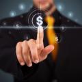 Businessman touching dollar sign