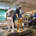 Sneaker and sports apparel company Under Armour reported lackluster North America sales and lowered earnings results, which caused stock values to plummet.